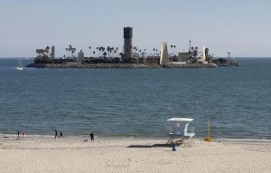 Occidental Petroleum Company sets up rig on beachfront view.